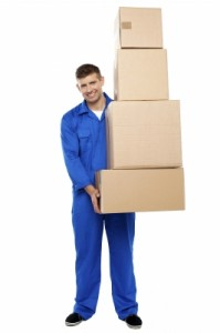 """Young Man Holding Cardboard Box"" by stockimages"